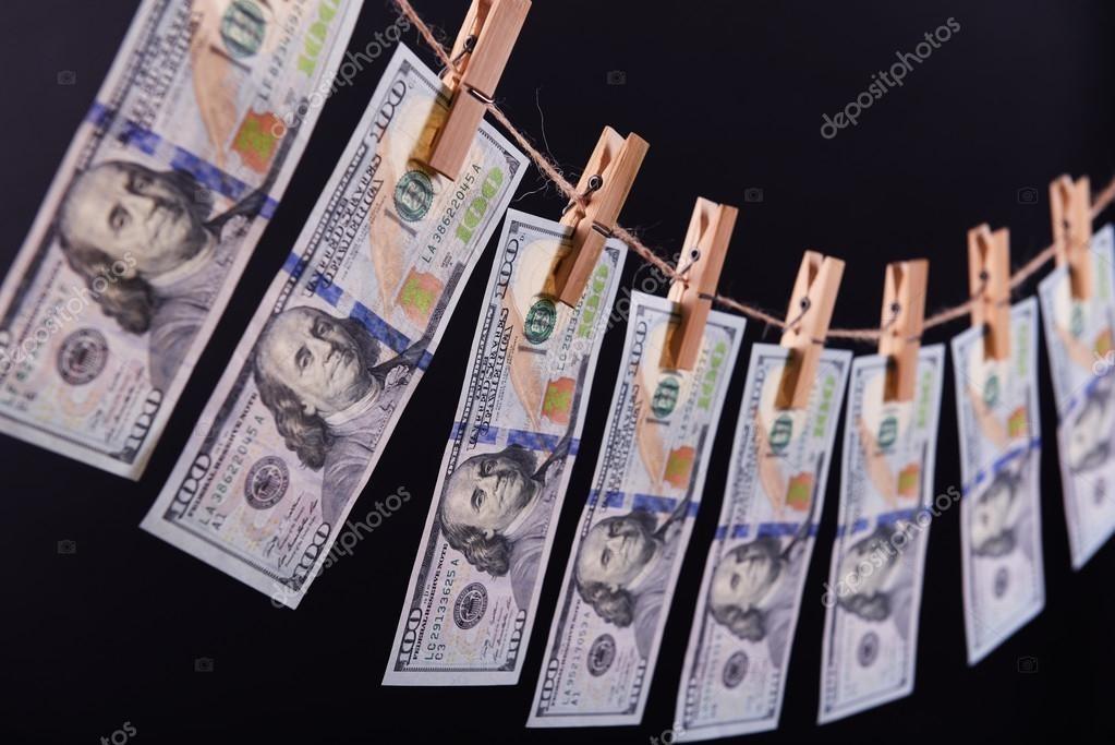 Șase exemple concrete în care serviciile avocaților și notarilor pot să fie folosite pentru spălare de bani